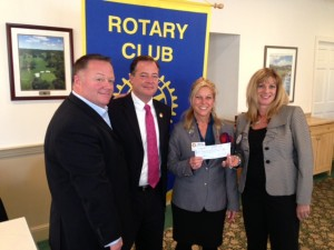 Pictured from left to right:  Bryan O'Rourke, Chair of Crimestoppers;  Anthony Kearns, Hunterdon County Prosecutor; Past-District Governor Megan Jones-Holt; and Lynn Hyman, Chair of the RCOF Donations Committee.  (photo by Harrie Copeland at Copper Hill Country Club at the 4/3/2013 Flemington Rotary Meeting)